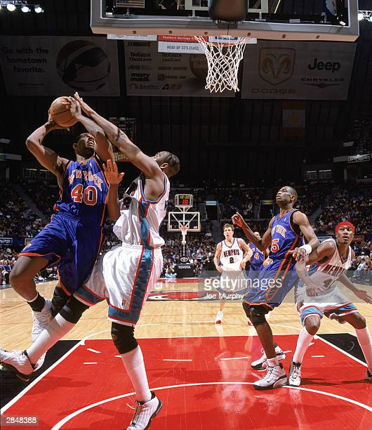 Kurt Thomas of the New York Knicks jumps to the basket against Lorenzen Wright of the Memphis Grizzlies during the game on December 26 2003 at The...