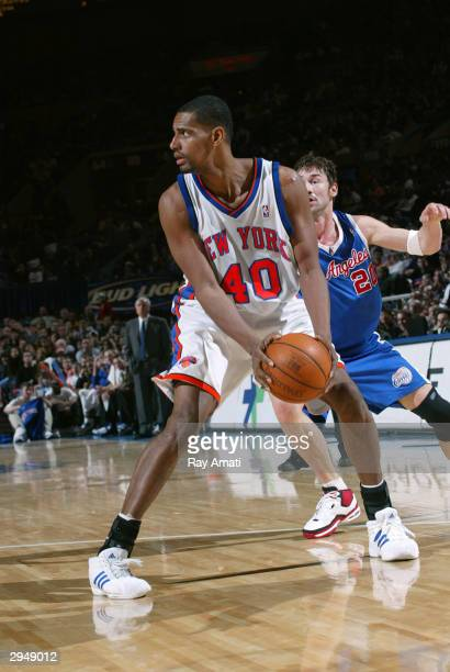 Kurt Thomas of the New York Knicks looks to pass against Marko Jaric of the Los Angeles Clippers on February 8 2004 at Madison Square Garden in New...