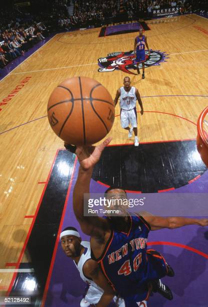 Kurt Thomas of the New York Knicks puts up a shot against Morris Peterson of the Toronto Raptors during a game at Air Canada Centre on January 19...