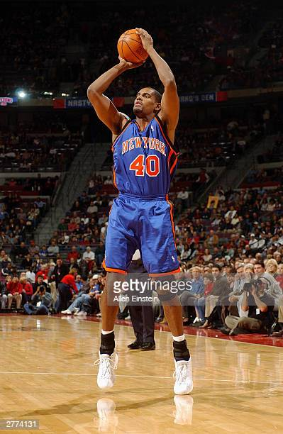 Kurt Thomas of the New York Knicks shoots against the Detroit Pistons during the game at the Palace of Auburn Hills on November 21 2003 in Auburn...