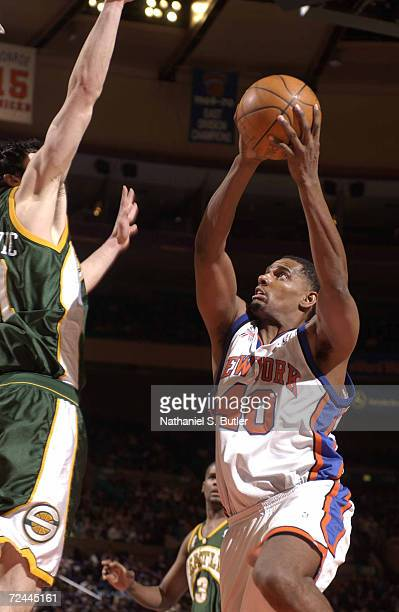 Kurt Thomas of the New York Knicks takes the ball to the basket during a game against the Seattle SuperSonics at Madison Square Garden in New York...