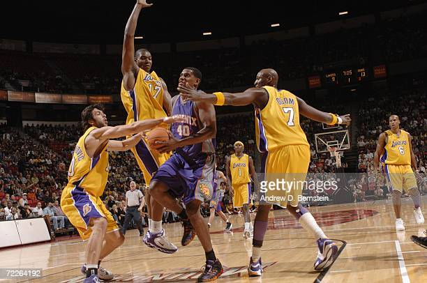 Kurt Thomas of the Phoenix Suns drives to the basket between Vladimir Radmanovic Andrew Bynum and Lamar Odom of the Los Angeles Lakers during a...