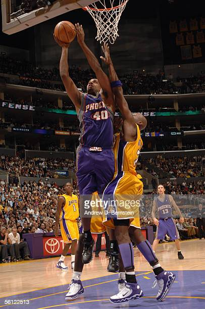 Kurt Thomas of the Phoenix Suns goes to the basket over Lamar Odom of the Los Angeles Lakers during the game at Staples Center on November 3 2005 in...