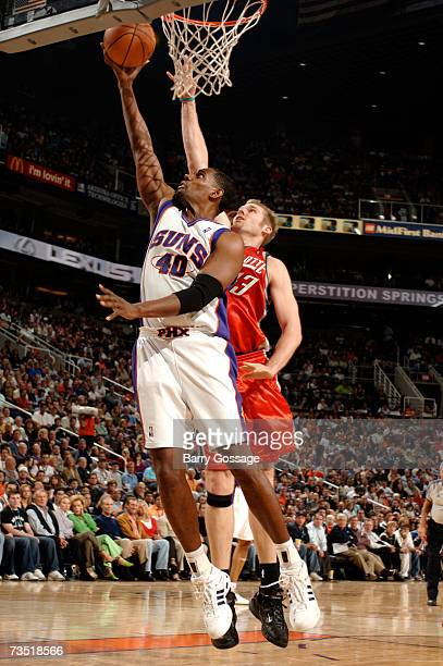 Kurt Thomas of the Phoenix Suns puts up a shot around Jake Voskuhl of the Charlotte Bobcats on March 7 2007 at US Airways Center in Phoenix Arizona...