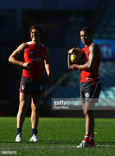 Kurt Tippett and Lance Franklin of the Swans look on during a Sydney Swans AFL training session at the Sydney Cricket Ground on June 8 2016 in Sydney...