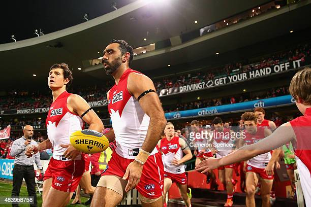 Kurt Tippett of the Swans and Adam Goodes of the Swans run onto the field during the round 20 AFL match between the Sydney Swans and the Collingwood...