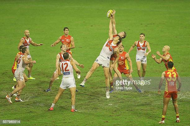 Kurt Tippett of the Swans and Tom Lynch of the Suns compete for the ball during the round 11 AFL match between the Gold Coast Suns and the Sydney...