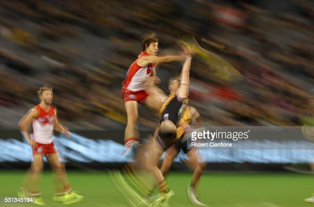 Kurt Tippett of the Swans and Tyrone Vickery of the Tigers compete for the ball during the round eight AFL match between the Richmond Tigers and the...