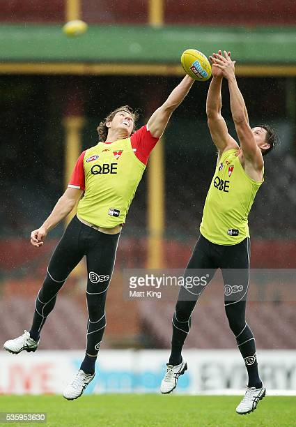 Kurt Tippett of the Swans competes against Callum Sinclair of the Swans during a Sydney Swans AFL training session at Sydney Cricket Ground on May 31...