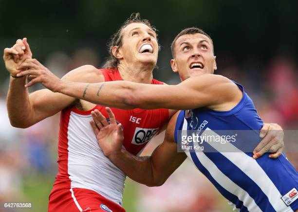 Kurt Tippett of the Swans competes for the ball against Braydon Preuss of the Kangaroos during the 2017 JLT Community Series match between the Sydney...