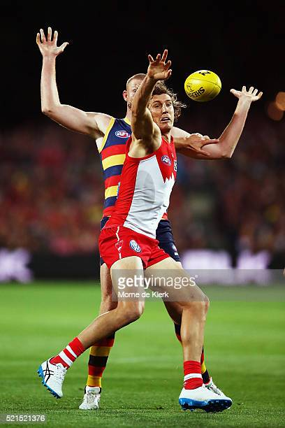 Kurt Tippett of the Swans competes for the ball with Sam Jacobs of the Crows during the round four AFL match between the Adelaide Crows and the...