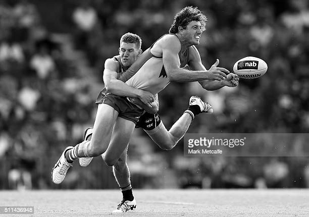 Kurt Tippett of the Swans handpasses the ball as he is tackled by Matthew White of the Power during the 2016 NAB Challenge AFL match between the...