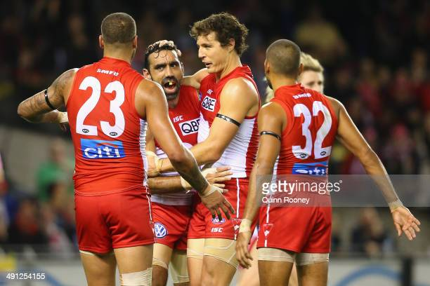 Kurt Tippett of the Swans is congratulated by Adam Goodes Lance Franklin and Lewis Jetta after kicking a goal during the round nine AFL match between...
