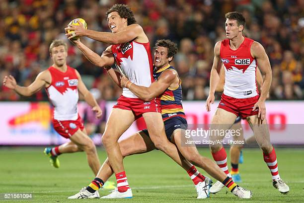 Kurt Tippett of the Swans is tackled by Kyle Hartigan of the Crows during the 2016 AFL Round 04 match between the Adelaide Crows and the Sydney Swans...