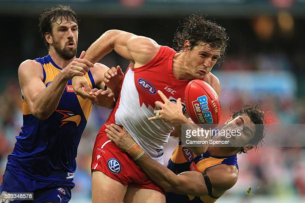 Kurt Tippett of the Swans is tackled during the round five AFL match between the Sydney Swans and the West Coast Eagles at Sydney Cricket Ground on...