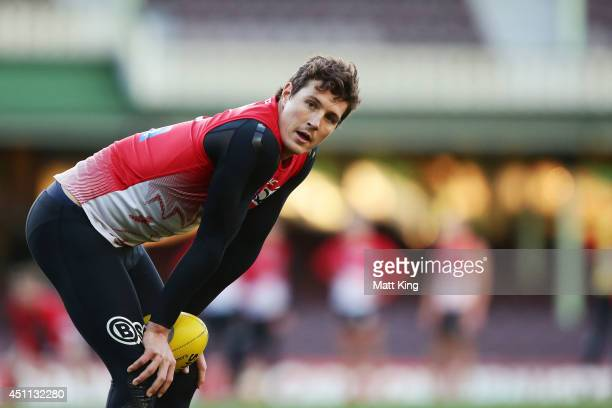 Kurt Tippett of the Swans looks on during a Sydney Swans AFL training session at Sydney Cricket Ground on June 24 2014 in Sydney Australia
