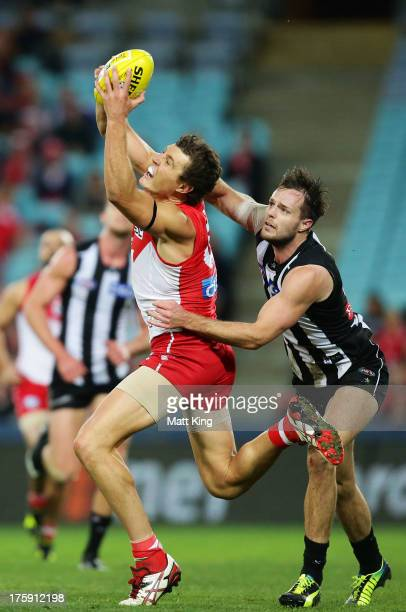 Kurt Tippett of the Swans marks in front of Nathan Brown of the Magpies during the round 20 AFL match between the Sydney Swans and the Collingwood...