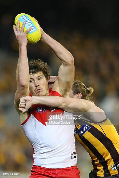 Kurt Tippett of the Swans marks the ball against Ryan Schoenmakers of the Hawks during the round 18 AFL match between the Hawthorn Hawks and the...