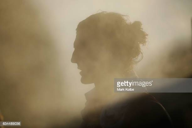 Kurt Tippett of the Swans Red cools down in front of the misting fans to combat the heat during the Sydney Swans AFL IntraClub match at Henson Park...