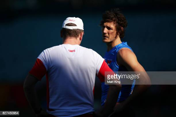 Kurt Tippett of the Swans talks to Swans head coach John Longmire during a Sydney Swans AFL training session at Sydney Cricket Ground on August 8...