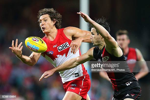 Kurt Tippett of the Swanscompetes with Matt Dea of the Bombers during the round seven AFL match between the Sydney Swans and the Essendon Bombers at...
