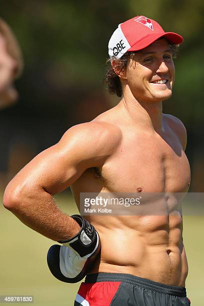 Kurt Tippett shares a joke with a team mate during a Sydney Swans AFL preseason training session at Lakeside Oval on December 1 2014 in Sydney...
