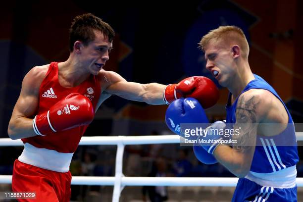 Kurt Walker of Ireland and Peter McGrail of Great Britain or Team GB compete in the Boxing Men's Bantamweight 56kg SemiFinal during Day 8 of the 2nd...