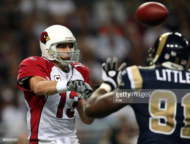 Kurt Warner of the Arizona Cardinals passes the ball over Leonard Little of the St. Louis Rams on November 2, 2008 at the Edwards Jones Dome in St....