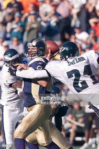 Kurt Warner of the St Louis Rams can''t get a pass off in the first half of the game against the Philadelphia Eagles at Veterans Stadium in...