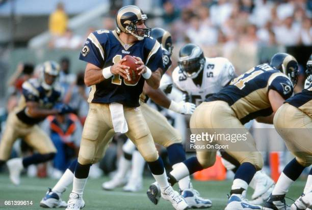 Kurt Warner of the St Louis Rams drops back to pass against the Philadelphia Eagles during an NFL football game September 9 2001 at Veterans Stadium...