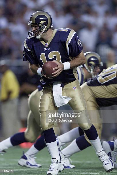 Kurt Warner of the St Louis Rams goes back for a pass during the game against the Philadelphia Eagles at Veterans Stadium in Philadelphia...