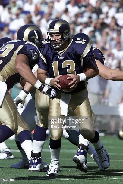 Kurt Warner of the St Louis Rams looks to make a hand off during the game against the Philadelphia Eagles at Veterans Stadium in Philadelphia...