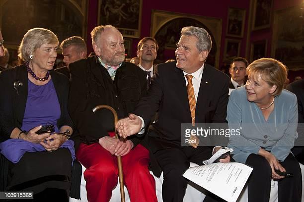 Kurt Westergaard and wife Gitte Joachim Gauck and German Chancellor Angela Merkel attend the M110 Media Award ceremony at Sanssouci Palace on...