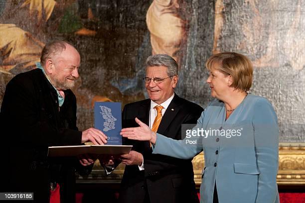 Kurt Westergaard Joachim Gauck and German Chancellor Angela Merkel attend the M110 Media Award ceremony at Sanssouci Palace on September 8 2010 in...