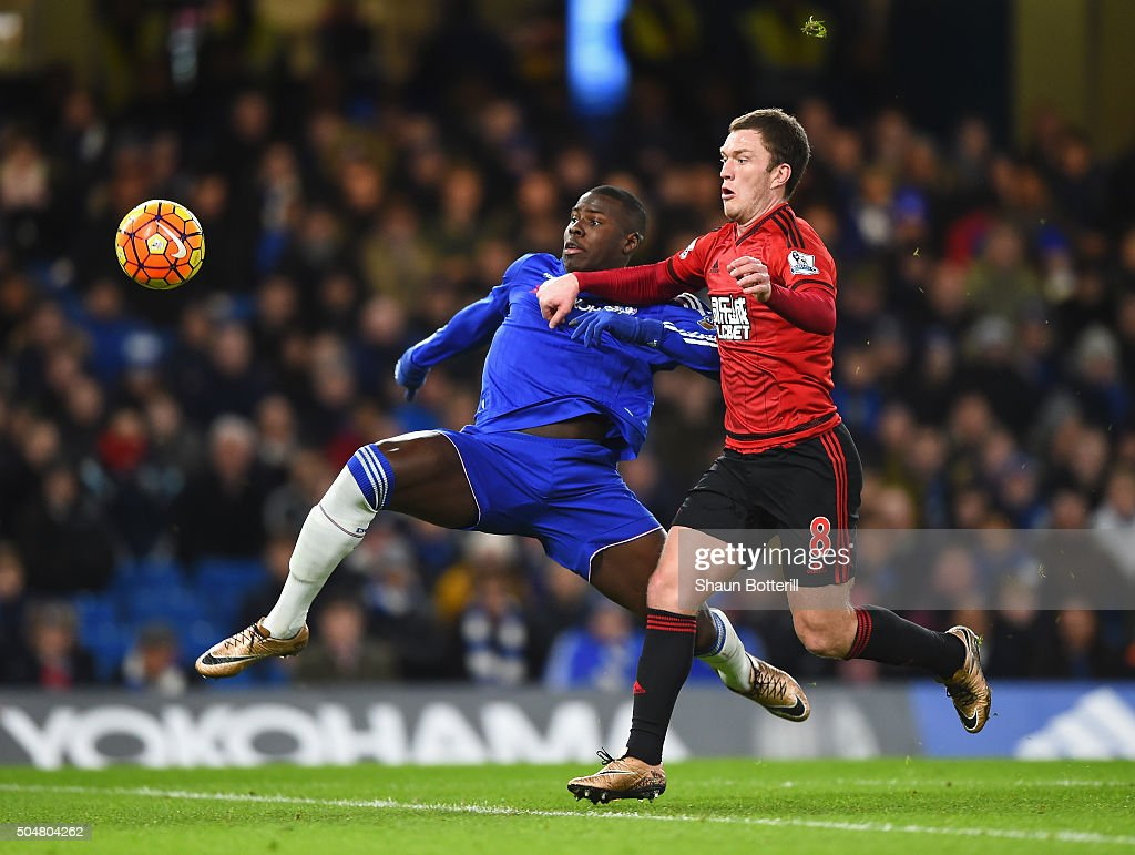 Kurt Zouma of Chelsea and Craig Gardner of West Bromwich Albion compete for the ball during the Barclays Premier League match between Chelsea and West Bromwich Albion at Stamford Bridge on January 13, 2016 in London, England.