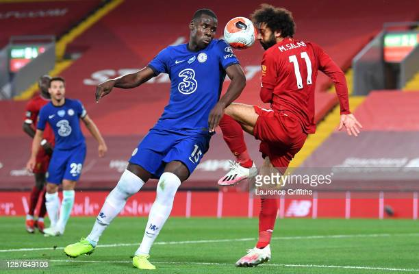 Kurt Zouma of Chelsea and Mohamed Salah of Liverpool battle for the ball during the Premier League match between Liverpool FC and Chelsea FC at...