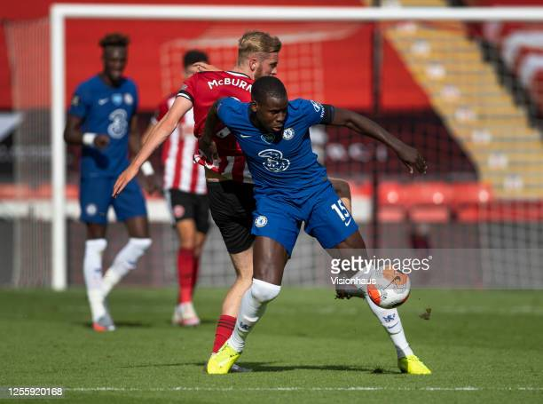 Kurt Zouma of Chelsea and Oli McBurnie of Sheffield United in action during the Premier League match between Sheffield United and Chelsea FC at...