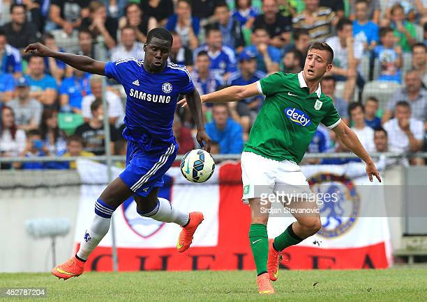 Kurt Zouma of Chelsea battle for the ball with Andraz Sporar of FC Olimpija Ljubljana during the Pre Season Friendly match between FC Olimpija...