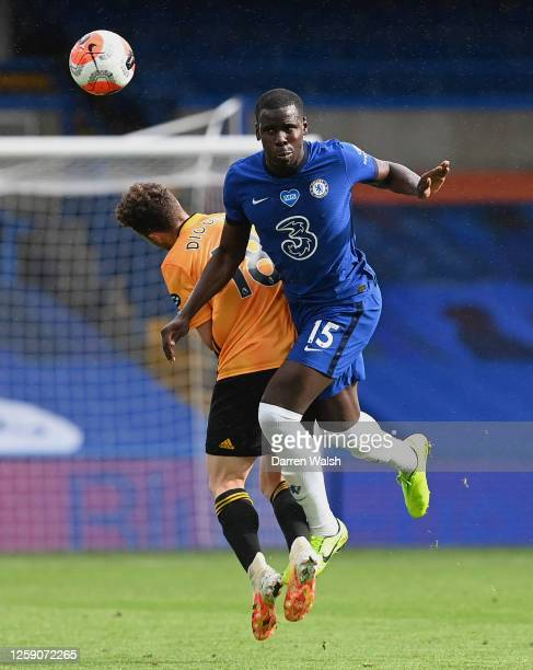 Kurt Zouma of Chelsea battles for possession with Diogo Jota of Wolverhampton Wanderers during the Premier League match between Chelsea FC and...