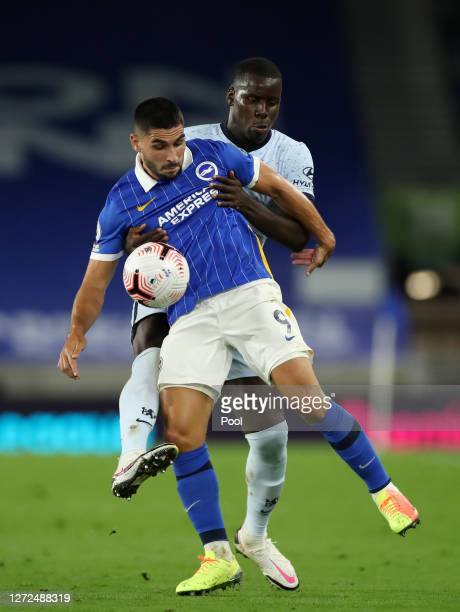 Kurt Zouma of Chelsea battles for possession with Neal Maupay of Brighton and Hove Albion during the Premier League match between Brighton Hove...