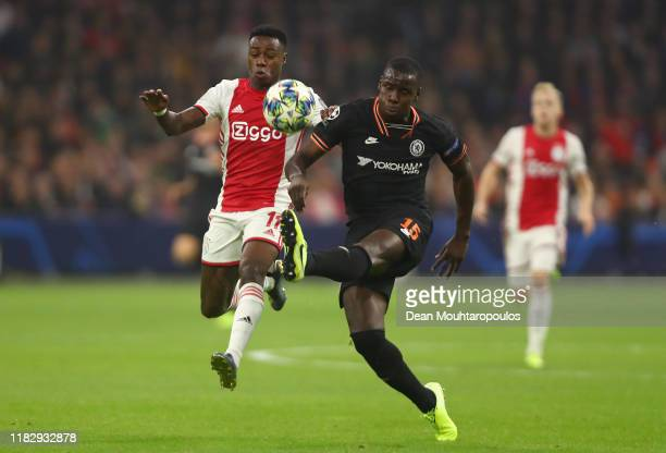 Kurt Zouma of Chelsea battles for possession with Quincy Promes of AFC Ajax during the UEFA Champions League group H match between AFC Ajax and...