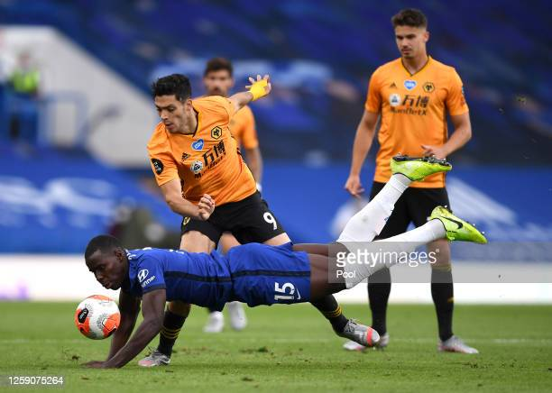 Kurt Zouma of Chelsea battles for possession with Raul Jimenez of Wolverhampton Wanderers during the Premier League match between Chelsea FC and...