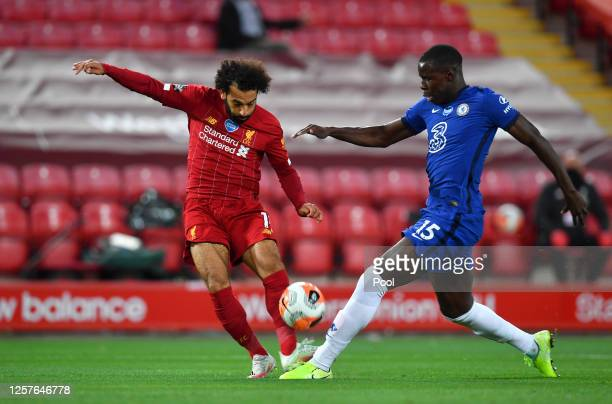 Kurt Zouma of Chelsea blocks Mohamed Salah of Liverpool during the Premier League match between Liverpool FC and Chelsea FC at Anfield on July 22...