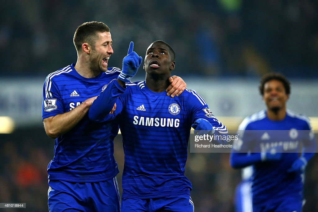 Kurt Zouma of Chelsea (2L) celebrates with Gary Cahill (L) as he scores their third goal during the FA Cup Third Round match between Chelsea and Watford at Stamford Bridge on January 4, 2015 in London, England.