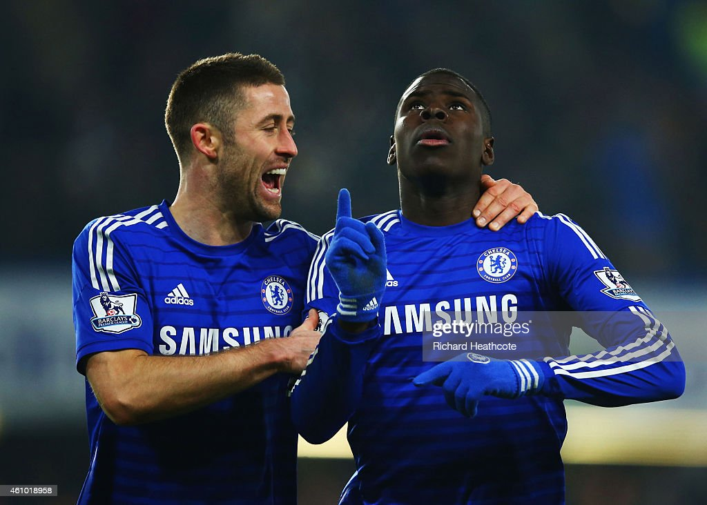 Kurt Zouma of Chelsea (R) celebrates with Gary Cahill (L) as he scores their third goal during the FA Cup Third Round match between Chelsea and Watford at Stamford Bridge on January 4, 2015 in London, England.
