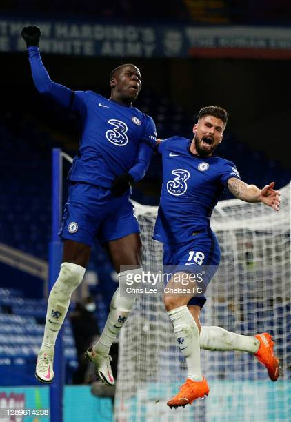Kurt Zouma of Chelsea celebrates with teammate Olivier Giroud after scoring their team's second goal during the Premier League match between Chelsea...