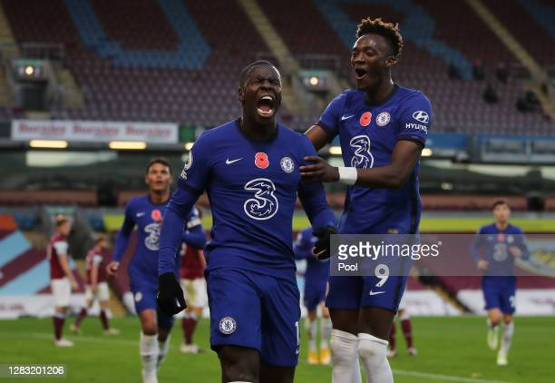 Kurt Zouma of Chelsea celebrates with teammate Tammy Abraham after scoring his team's second goal during the Premier League match between Burnley and...