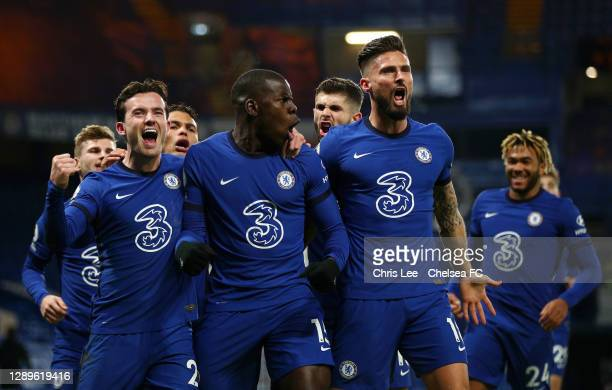 Kurt Zouma of Chelsea celebrates with teammates Ben Chilwell and Olivier Giroud after scoring their team's second goal during the Premier League...