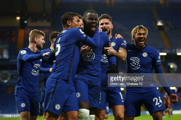 Kurt Zouma of Chelsea celebrates with teammates Thiago Silva, Olivier Giroud and Reece James after scoring their team's second goal during the...