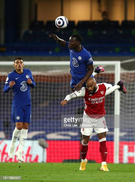 Kurt Zouma of Chelsea challenges for the high ball with Alexandre Lacazette of Arsenal during the Premier League match between Chelsea and Arsenal at...